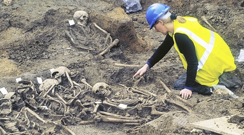 MOLA archaeologists excavating burial pit